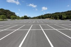 Asphalt parking lot sealcoating